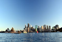 Opera House and the business district's skycrapers from Kirribilli. Stock Images