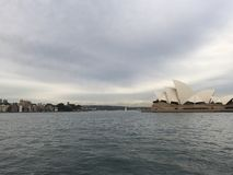 Opera house. Feel the sound breaking up the sky and Stock Photos