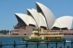 The Opera House with a ferry that sails out from Circular Quay i Stock Photo