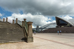 Opera House forecourt harbour bridge stone stairs. Looking across the Sydney Opera House forecourt to the pylons of the harbour bridge and a sandstone sandstone Royalty Free Stock Photos