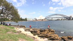 Opera House, harbour bridge and cruise ship Mrs Macquarie`s chair stock footage