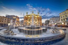Opera House in Lviv. Lviv Theatre of Opera and Ballet illuminated at dusk with water fountain in foreground, Ukraine Stock Photography