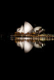 Opera House Night at Night. Sydney's World Famous Opera House at night with reflection in the harbor royalty free stock photos