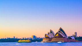 Opera House with passing boats Royalty Free Stock Photography