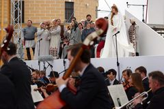 Opera Ruslan and Lyudmila outdoors. St. Petersburg, Russia - July 12, 2017: Actors and musicians perform the opera Ruslan and Lyudmila outdoors during the Stock Photo