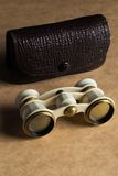 Opera, theater. White binoculars on the table Royalty Free Stock Photography