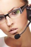 Operador agradable del teléfono directo con el receptor de cabeza Imagen de archivo libre de regalías