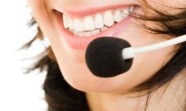 Operador bonito do centro de chamadas da mulher com auriculares Imagens de Stock
