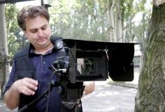 Operador cinematográfico de trabalho Imagens de Stock