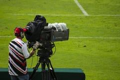 Operador cinematográfico no evento de esportes Imagem de Stock