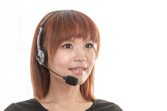 Operador da linha de ajuda com auriculares fotografia de stock royalty free