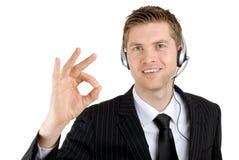 Operador da sustentação do serviço de atenção a o cliente que dá o sinal aprovado fotos de stock