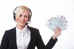 Operador de centro de atendimento com dinheiro fotos de stock royalty free