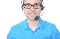 Operador de centro de atención telefónica de sexo masculino joven en traje Imagen de archivo