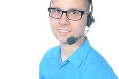 Operador de centro de atención telefónica de sexo masculino joven en traje Foto de archivo libre de regalías