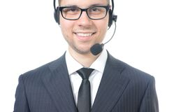 Operador de centro de atención telefónica de sexo masculino joven en traje Fotos de archivo