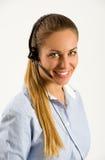 Operador de centro de atención telefónica joven sonriente Fotografía de archivo
