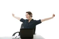 Operador de centro de llamada que estira sus brazos Imágenes de archivo libres de regalías