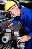 Operador de máquina no trabalho Foto de Stock Royalty Free