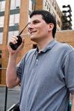 Operador de rádio na frente do edifício fotos de stock royalty free