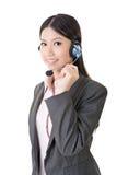 Operador de sexo femenino alegre del teléfono de la atención al cliente Foto de archivo libre de regalías