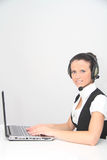 Operador de sexo femenino de la atención al cliente con el receptor de cabeza Imagen de archivo