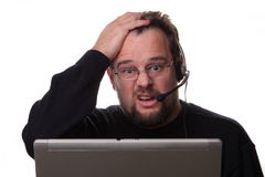 Operador de sexo masculino de mirada confuso Imágenes de archivo libres de regalías