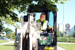 Operador de uma máquina escavadora Imagem de Stock Royalty Free