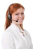 Operador del teléfono de la ayuda del centro de atención telefónica en las auriculares aisladas Foto de archivo libre de regalías