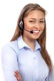 Operador del teléfono de la ayuda en las auriculares aisladas Foto de archivo