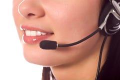 Operador del teléfono directo con el receptor de cabeza aislado en blanco Imágenes de archivo libres de regalías