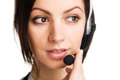 Operador hermoso joven del centro de atención telefónica Imagen de archivo libre de regalías