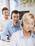 Operador que fala em auriculares Foto de Stock