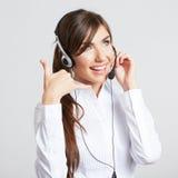 Operador sonriente del centro de atención telefónica con las auriculares del teléfono Imagen de archivo