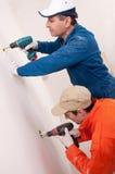 Operai di costruzione sul lavoro Fotografia Stock
