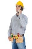 Operaio che comunica sul telefono Fotografia Stock Libera da Diritti