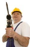 Operaio con la perforatrice ed il casco di sicurezza Immagine Stock
