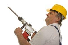 Operaio con la perforatrice ed il casco di sicurezza Fotografie Stock Libere da Diritti