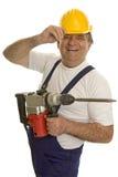 Operaio con la perforatrice ed il casco di sicurezza Fotografia Stock Libera da Diritti