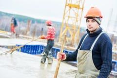 Operaio del costruttore al cantiere Fotografia Stock