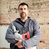 Operaio del muratore dell'uomo del martello di demolizione fotografia stock