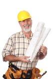 Operaio di costruzione con le cianografie fotografia stock libera da diritti