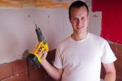 Operaio di costruzione con un trivello Fotografie Stock