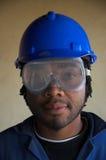 Operaio di costruzione e maschera di protezione dell'occhio Fotografie Stock