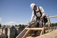 Operaio di costruzione sul lavoro Immagine Stock