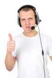 operatör över uppvisning av telefontumen upp white Royaltyfri Fotografi