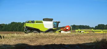 Two agricultural machines operate in the field, grain harvesting machines operate in the field, agricultural land. Operate in the field, agricultural land, ain Stock Photography