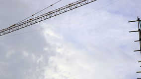 The operating arm of crane moving in a building construction site stock video footage