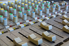 Operating of the Audio Mixer. Close-Up View. Royalty Free Stock Photo