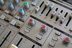 Operating of the Audio Mixer. Close-Up View. Royalty Free Stock Images
